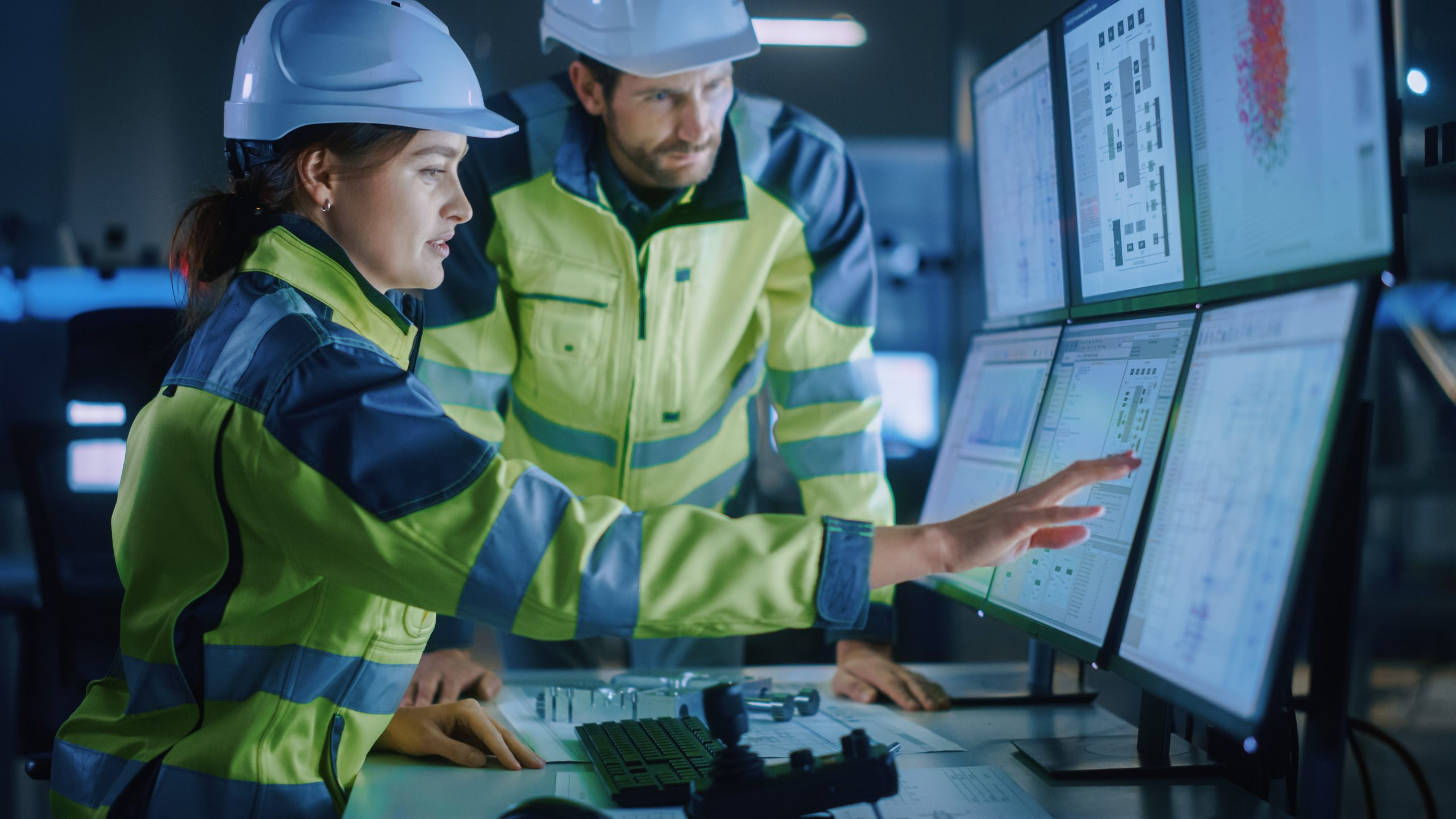 Industry 4.0 Modern Factory: Project Engineer Talks to Female Operator who Controls Facility Production Line, Uses Computer with Screens Showing AI, Machine Learning Enhanced Assembly Process; Shutterstock ID 1936499779; purchase_order: -; job: -; client: -; other: -